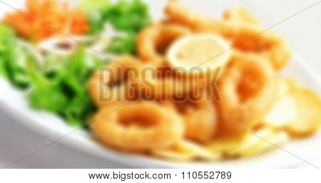Deep Batter Fried Squid Rings Calamari With Green Salad. In Blur Style