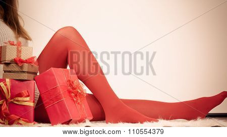 Woman In Red Pantyhose With Many Gift Boxes