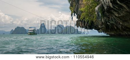 The Tourist Boat On The Bay Near Karst Islands. Islands At Phang Nga Bay Near Krabi And Phuket. Thai