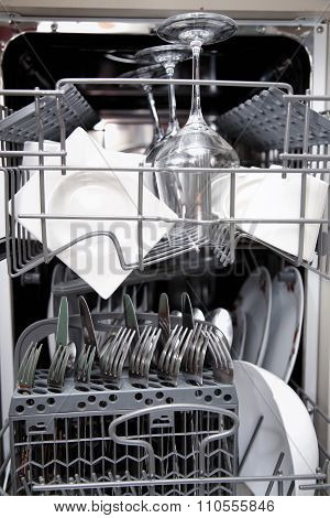 Open Dishwasher With Clean Utensils