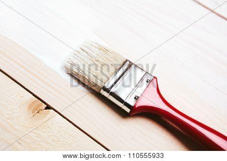 Varnishing a wooden shelf