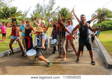 SAINT-PIERRE, REUNION ISLAND, FRANCE - NOVEMBER 8, 2015: Unidentified street musicians and performers singing and dancig in the park. Traditional african music on public event.