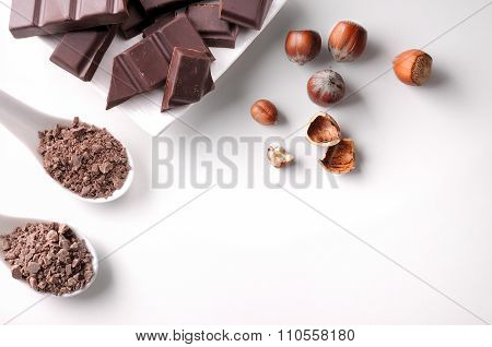 Portions And Chocolate Chips On Container With Hazelnuts Isolated Top