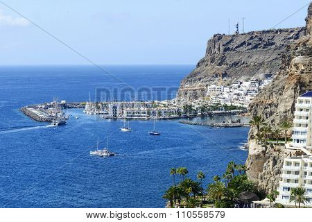PUERTO DE MOGAN - NOVEMBER 26: Aerial view of old town and marina Puerto de Mogan on 26 November 2015 in Puerto de Mogan, Gran Canaria Island. This is popular winter tourist destination from Europe.