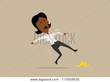 Businesswoman slipped on a banana peel