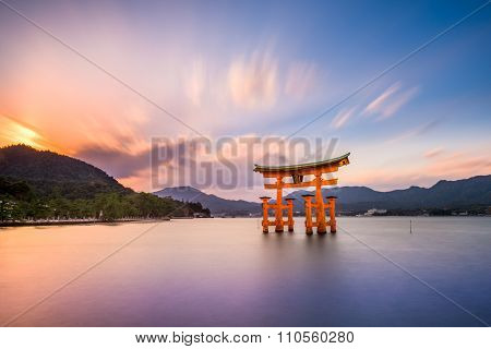 Miyajima, Hiroshima, Japan at the great gate of Itsukushima shrine. (gate sign reads Itsukushima Shrine)