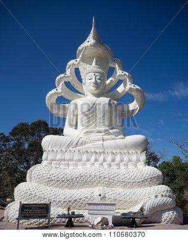 White Buddha Statue With Naga Seven Heads On Blue Sky Background