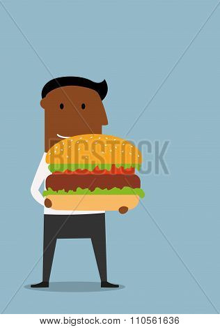 Businessman with large appetizing hamburger