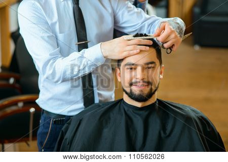 Professional barber  making haircut