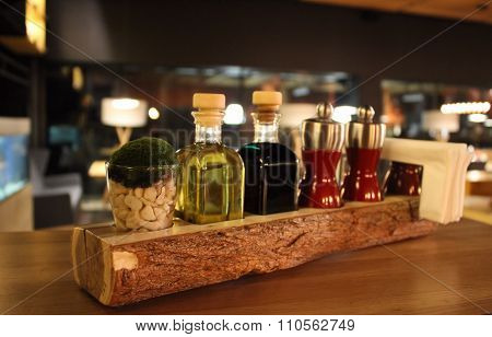 Styling set of spices and seasonings on the restaurant table