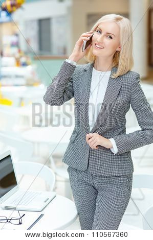 Nice woman standing in the cafe