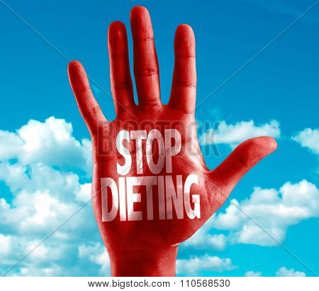 Stop Dieting written on hand with sky background
