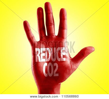 Reduce CO2 written on hand with yellow background