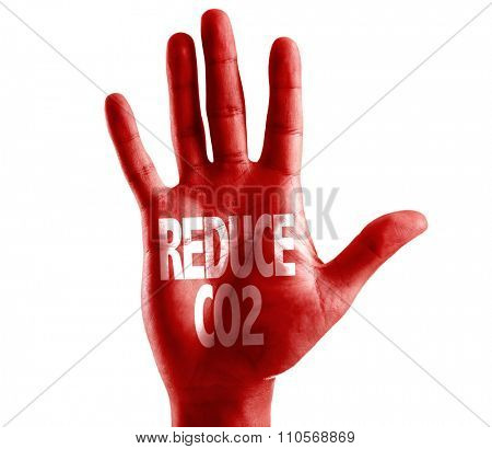 Reduce CO2 written on hand isolated on white background