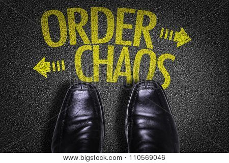 Top View of Business Shoes on the floor with the text: Order - Chaos