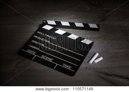 Movie clapper on boards cinematography abstract sign