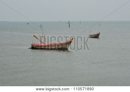 fishery boat floating on dull sea