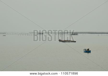 boat floating on dull sea