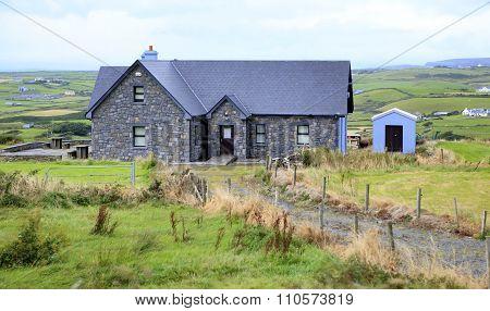 Rural farmhouses among farmland.