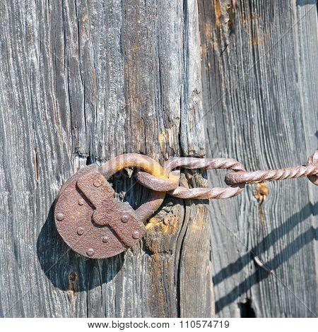 Old Padlock On The Ramshackle Doors
