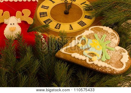gingerbread and old wooden cuckoo clock and branch Christmas tree