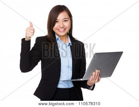 Asian Young Businesswoman use of the laptop computer and thumb up
