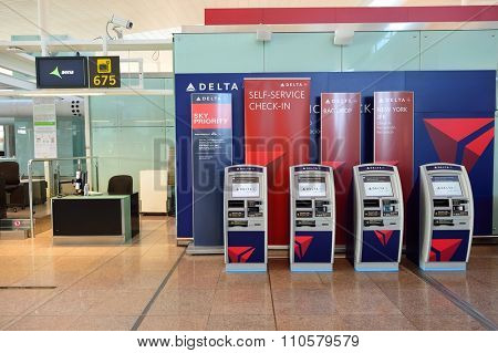 BARCELONA, SPAIN - NOVEMBER 20, 2015: check-in kiosks in Barcelona airport. Barcelona international airport is the main airport of Catalonia and one of the busiest in the world