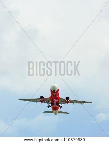 PHUKET, THAILAND - NOVEMBER 06, 2015: AirAsia Airbus A320 take-off. AirAsia Berhad is a Malaysian low-cost airline headquartered near Kuala Lumpur, Malaysia