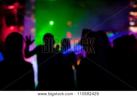 Silhouettes of people dancing  in nightclub at a party