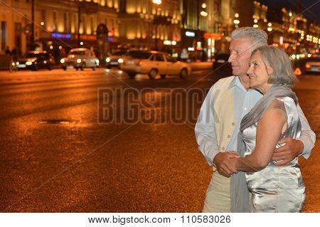 old couple  on night street