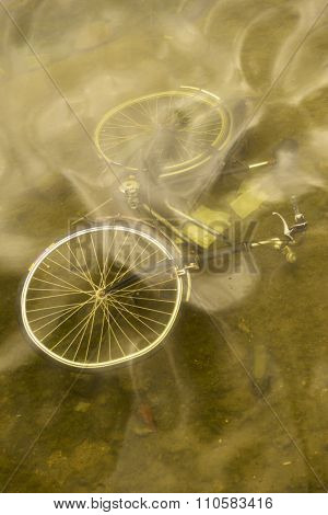 Abandoned bicycle in the water