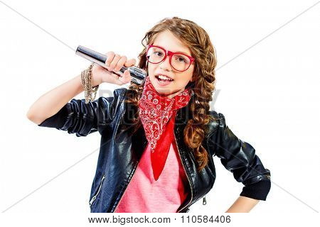 Modern girl teenager singing on a stage with expression. Isolated over white.