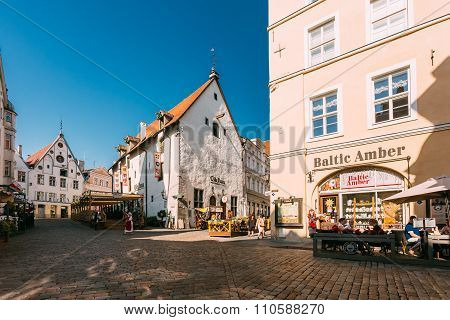 People walk through old streets of city Tallinn in Estonia