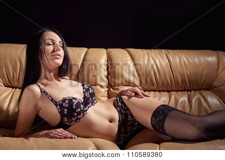 Sexy woman posing in sensual black lingerie