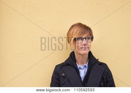 Waist Up Portrait Of Lady On Yellow Plastered Wall Background