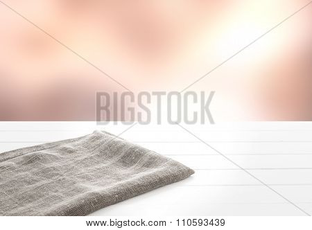 Kitchen towel on white wooden table