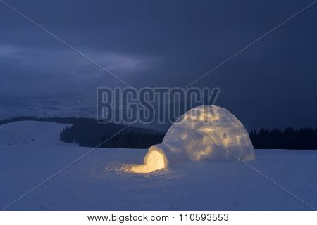 Night landscape. Snow igloo in mountains. Extreme housing for tourists