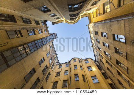 Bottom view on a typical courtyard-a well in the old district of St. Petersburg in Russia.