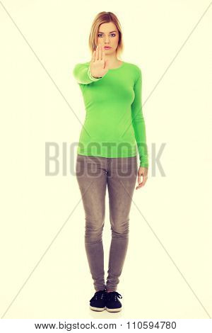 Young caucasian woman with stop gesture.