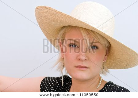 Somber Woman in Hat