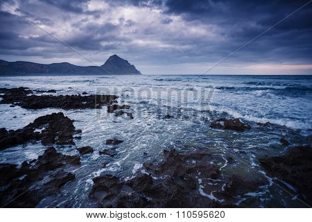 Fantastic view of the nature reserve Monte Cofano. Dramatic scene. Overcast sky. Location cape San Vito. Sicilia, Italy, Europe. Mediterranean and Tyrrhenian sea. Beauty world.