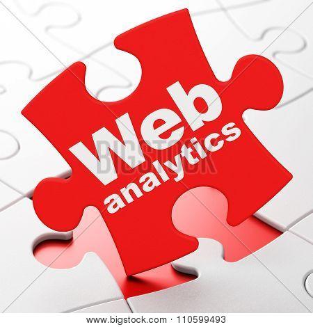 Web development concept: Web Analytics on puzzle background