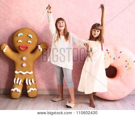 girls in confectionery designed room