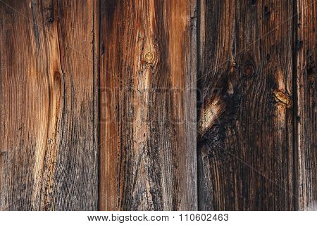The brown background of wooden boards