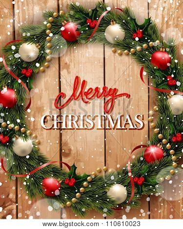 Christmas wreath on wood background.