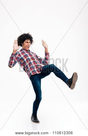Full length portrait of a young afro american man slipping isolated on a white background