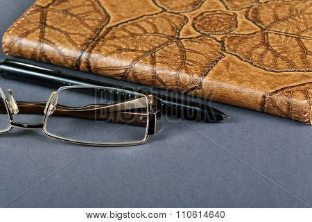 Pencil Glasses And A Writing-book Close Up