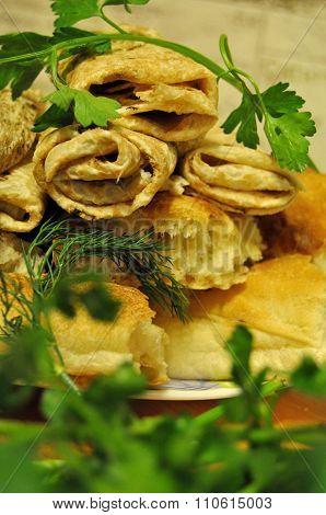 Fresh bread, pita bread, fragrant green parsley green parsley and basil