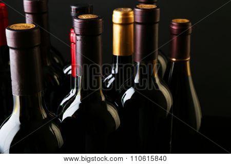 Wine bottles neck on dark background, close up