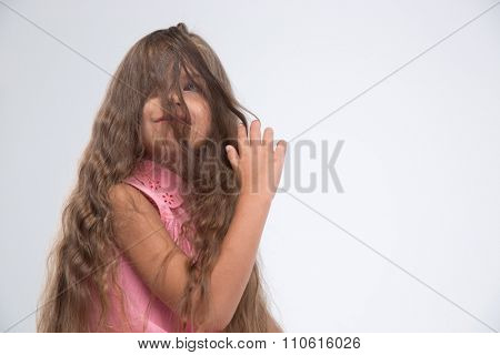Portrait of a little girl having fun isolated on a white background